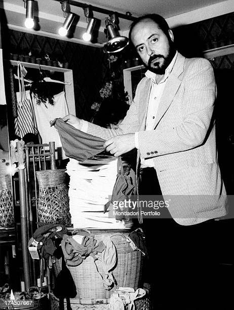 The Italian stylist Elio Fiorucci is inside one of the homonymous boutiques he owns showing a thong Milan 1974