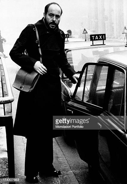 The Italian stylist Elio Fiorucci opens the door of a taxi Milan 1971