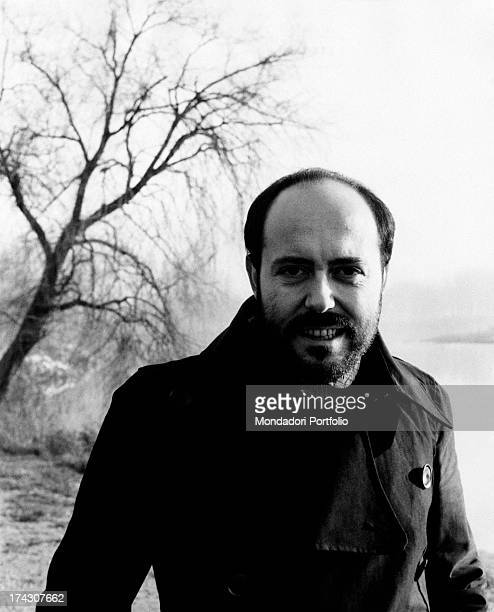 The Italian stylist Elio Fiorucci photographed near a tree while looking at the camera Milan 1971