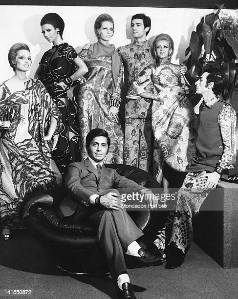 The Italian stylist Valentino sitting in his atelier in Via Gregoriana surrounded by models Rome July 1967