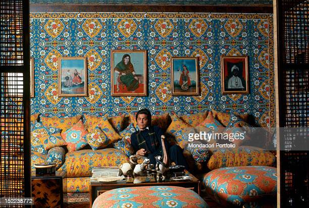 The Italian stylist Valentino sitting in the living room of his house in the 'AppioPignatelli' district Rome 1974