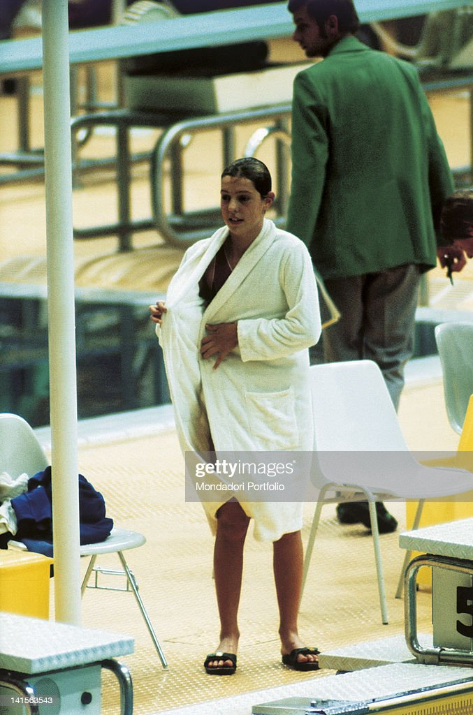 Novella calligaris at the olympic games pictures getty images the italian swimmer novella calligaris puts on her bathrobe after a race at the games of thecheapjerseys Choice Image
