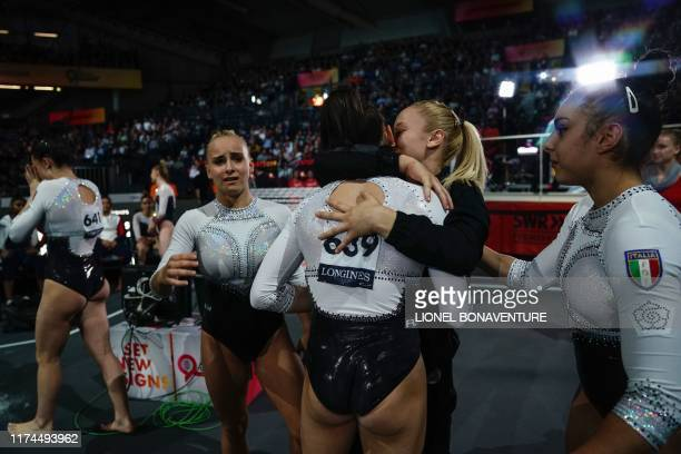 The Italian team celebrate after the womens team final at the FIG Artistic Gymnastics World Championships at the HannsMartinSchleyerHalle in...
