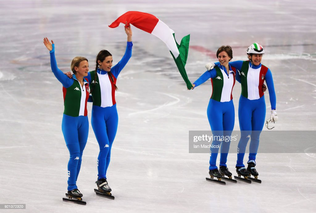 The Italian team celebrate as win the silver medal following the Ladies Short Track Speed Skating 3000m Relay Final A on day eleven of the PyeongChang 2018 Winter Olympic Games at Gangneung Ice Arena on February 20, 2018 in Gangneung, South Korea.