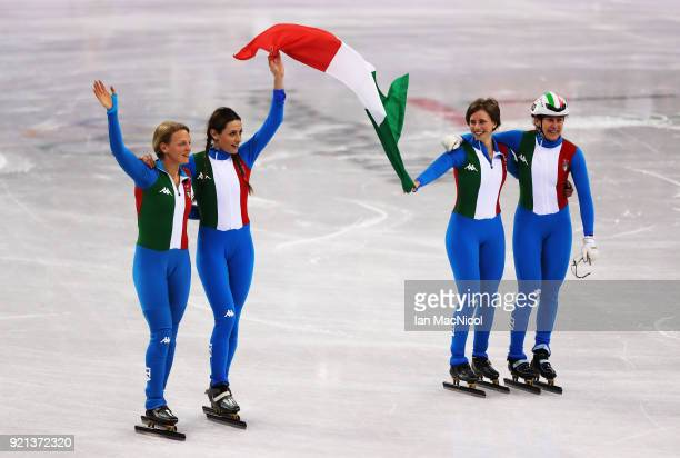 The Italian team celebrate as win the silver medal following the Ladies Short Track Speed Skating 3000m Relay Final A on day eleven of the...