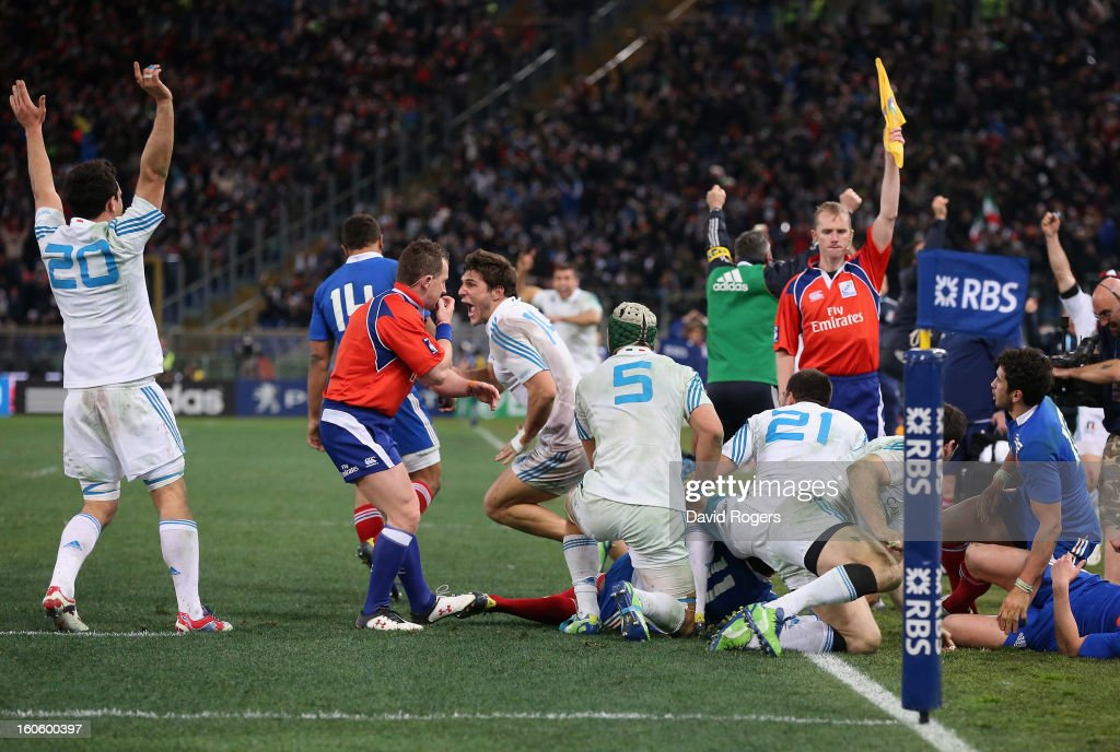 The Italian team celebrate their victory as Nigel Owens, the referee, blows the final whistle during the RBS Six Nations match between Italy and France at Stadio Olimpico on February 3, 2013 in Rome, Italy.