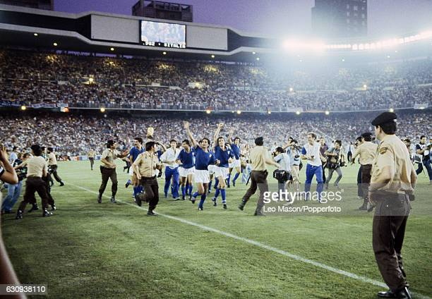 The Italian team led by Claudio Gentile and Marco Tardelli parade the trophy following their victory over West Germany in the FIFA World Cup Final at...