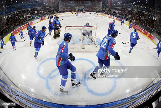 The Italian team skate around the goal in their pre match warm up in the men's ice hockey Preliminary Round Group A match between Finland and Italy...