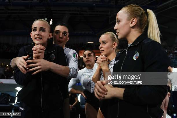 The Italian team wait for their results after the womens team final at the FIG Artistic Gymnastics World Championships at the...