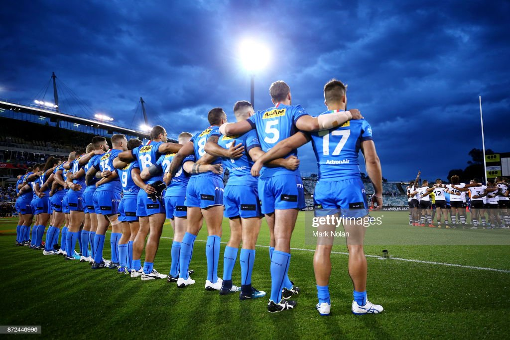 The Italian team watch on as the Fijian side sing a hym before the 2017 Rugby League World Cup match between Fiji and Italy at Canberra Stadium on November 10, 2017 in Canberra, Australia.