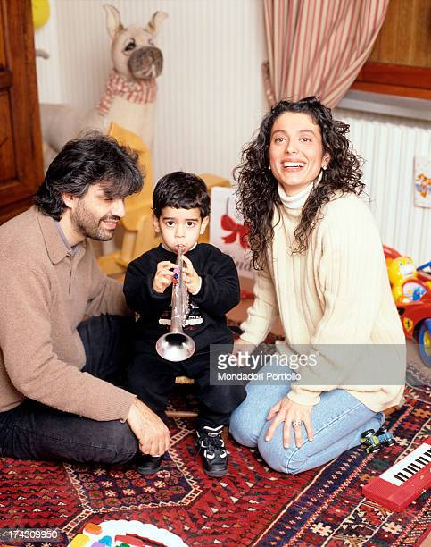 The Italian tenor Andrea Bocelli in his house in Tuscany with his wife Enrica Cenzatti and their two years old son Amos all seated on an eastern...