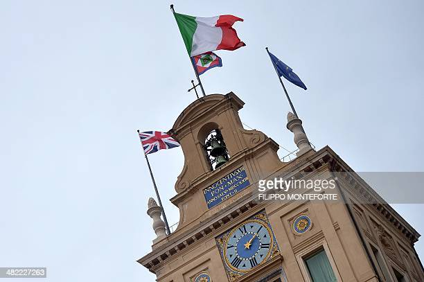 The Italian the European Union and the British flags fly atop Rome's Quirinale palace during Britain's Queen Elizabeth II's official visit on April 3...