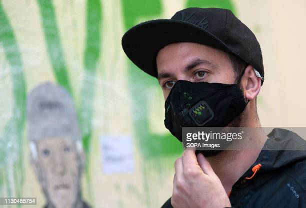 The Italian urban artist TVBOY is seen in front of a mural at the 'Soho' urban district in down town Malaga The participation of urban artist TVBOY...
