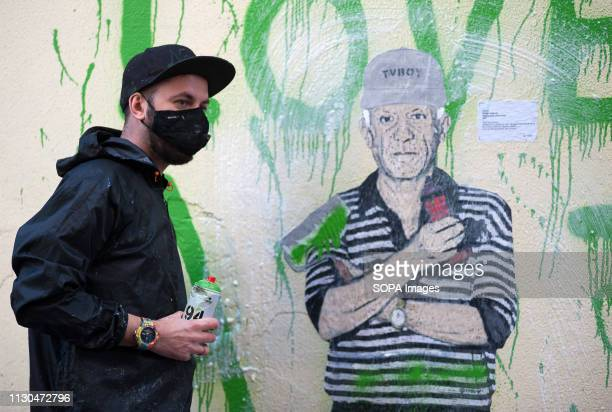 The Italian urban artist TVBOY is seen painting a mural at the 'Soho' urban district in down town Malaga The participation of urban artist TVBOY is...