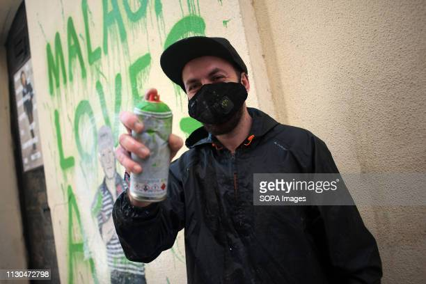 The Italian urban artist TVBOY is seen posing for photographers in front of a mural at the 'Soho' urban district in down town Malaga The...