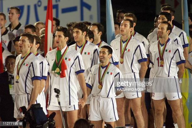 The Italian volleyball team sing their national anthem in the award ceremony for the men's World Volleyball Championships in Tokyo 29 November...