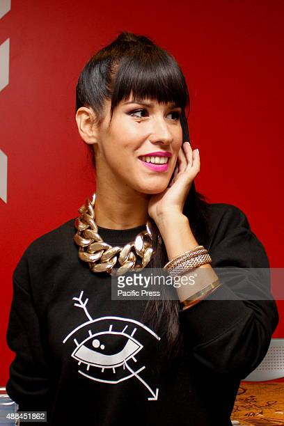 The Italian woman rapper Claudia Nahum also known as 'Baby K' poses during the autograph signing of her new album 'Kiss Kiss Bang Bang' preceded by...