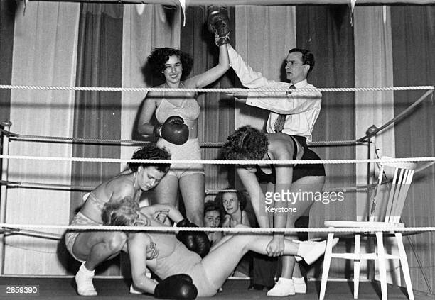 The Italian women's boxing champion celebrates after knocking out the London champion during a women's international boxing match in Stockholm