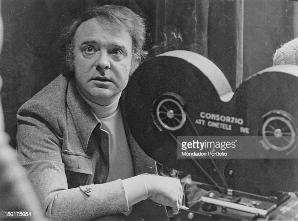 The Italian writer and director Alberto Bevilacqua next to the camera during the filming of 'Eye of the Cat' Italy 10th April 1975