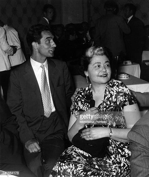 The Italian writer Italo Calvino sitting in a bar in the company of signora Vivante