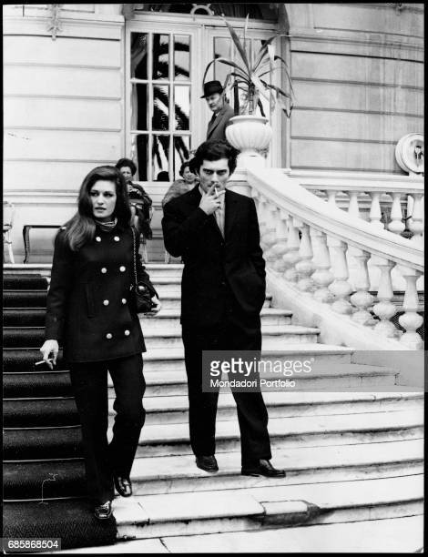 The Italian-French singer Dalida and Italian singer Luigi Tenco descend the steps of the Casino in the afternoon of the day before the singer's...