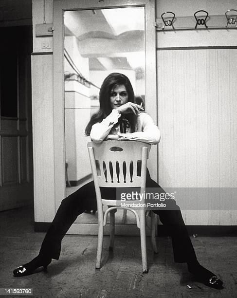 The ItalianFrench singer Dalida posing on a chair at the 17th edition of the Italian Song Festival where she has presented the song 'Ciao amore ciao'...