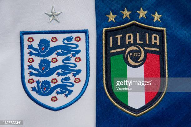 The Italy and England badges on their first team home shirts ahead of the Euro 2020 final at Wembley Stadium on July 8, 2021 in Manchester, United...