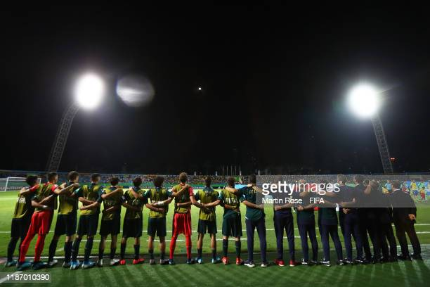 The Italy Coaching Staff and Reserves line up for the national anthems during the FIFA U-17 World Cup Quarter Final match between Italy and Brazil at...