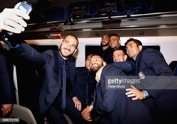 The Italy player Leonardo Bonucci makes a selfie with his teammates as depart for Coverciano on the Frecciarossa 1000 train at Stazione Termini on...