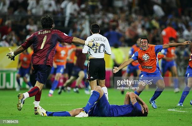 The Italy players celebrate victory as the final whistle is blown at the end of the FIFA World Cup Germany 2006 Semifinal match between Germany and...