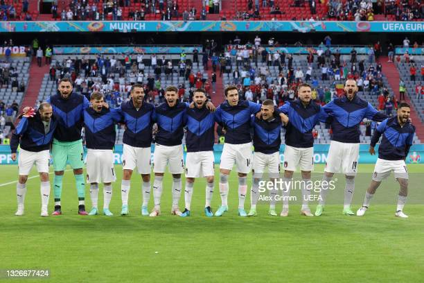 The Italy players sing their national anthem prior to the UEFA Euro 2020 Championship Quarter-final match between Belgium and Italy at Football Arena...