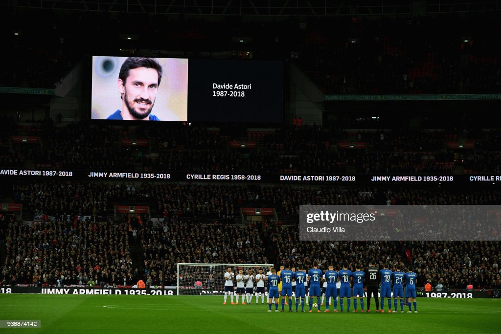 The Italy team and the England team observe a minutes silence in memory of Jimmy Armfield, Cyrille Regis, and Davide Astori (pictured on the screen) prior to the the International friendly football match between England and Italy at Wembley Stadium on March 27, 2018 in London, England.