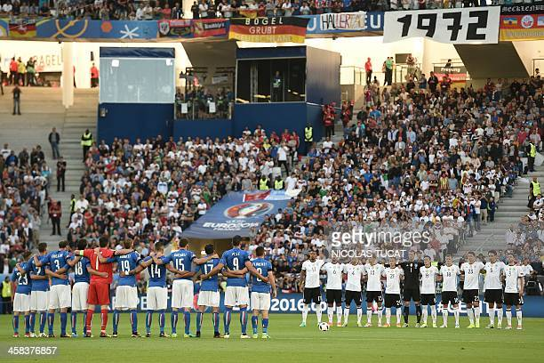 The Italy team and the German team from left Germany's defender Jerome Boateng Germany's midfielder Sami Khedira Germany's defender Benedikt Hoewedes...