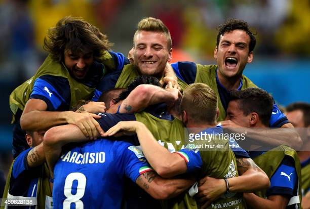 The Italy team celebrate after scoring a goal during the 2014 FIFA World Cup Brazil Group D match between England and Italy at Arena Amazonia on June...