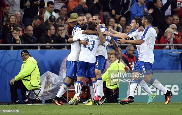 The Italy team celebrate the goal of Italy's midfielder Emanuele Giaccherini during the Euro 2016 group E football match between Belgium and Italy at...