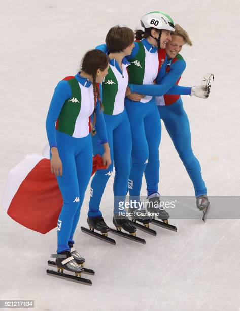 The Italy team celebrate winning the silver medal as the China team are disqualified the Ladies Short Track Speed Skating 3000m Relay Final A on day...