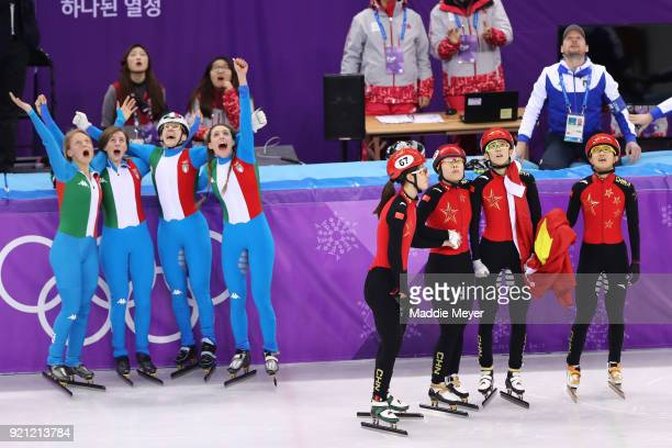 The Italy team celebrate winning the silver medal as the disqualified China team look on following the Ladies Short Track Speed Skating 3000m Relay...