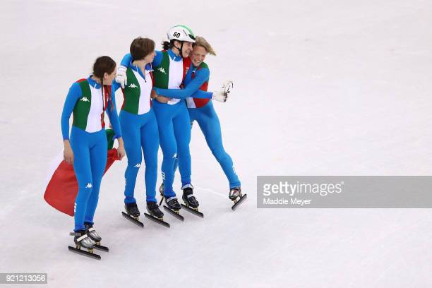 The Italy team celebrate winning the silver medal following the Ladies Short Track Speed Skating 3000m Relay Final A on day eleven of the PyeongChang...