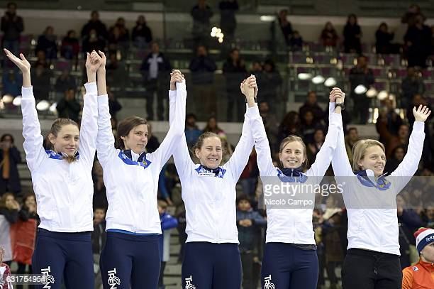The Italy team celebrates on the podium of 3000m Ladies Realy during the European Short Track Speed Skating championships in Turin