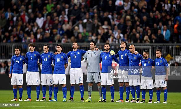 The Italy team observe a minutes silence prior to the international friendly match between Germany and Italy at Allianz Arena on March 29 2016 in...