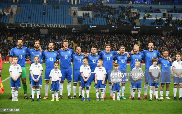 The Italy team sing the national anthem prior to the International friendly match between Italy and Argentina at Etihad Stadium on March 23 2018 in...