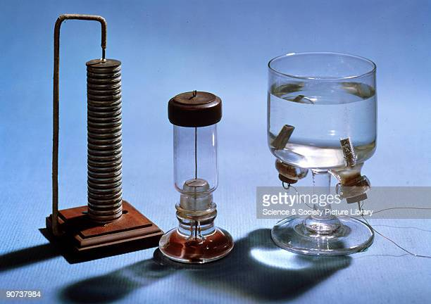 The item on the left is a reproduction of the voltaic pile used by Anthony Carlisle and William Nicholson to electrolyse water in 1800. The...