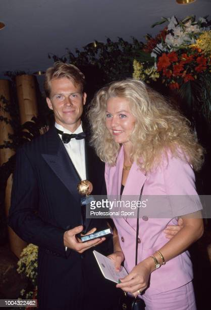 The ITF Men's Singles World Champion Stefan Edberg of Sweden and his wife Annette pose with the trophy at the ITF World Champions Dinner during the...