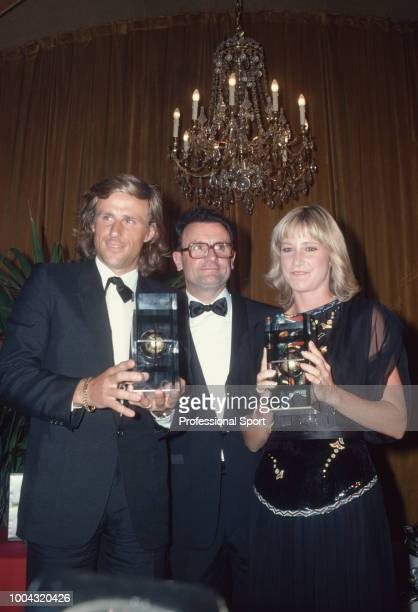 The ITF Singles World Champions Bjorn Borg of Sweden and Chris EvertLloyd of the USA pose with Philippe Chatrier and their trophies at the ITF World...