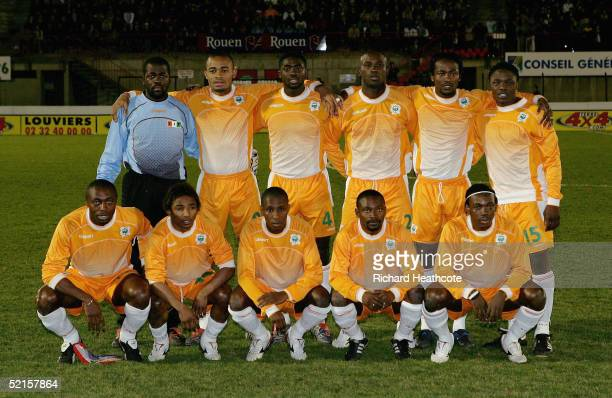 The Ivory Coast players line up for a team group before the international friendly match between the Ivory Coast and Congo DR held at Rouen FC on...