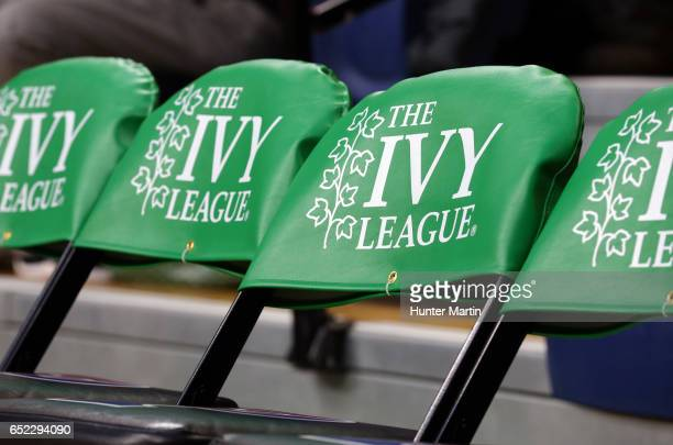 The Ivy League logo is displayed on chairs on the players bench during a game between the Princeton Tigers and the Pennsylvania Quakers at The...