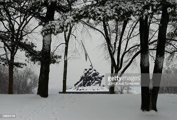 The Iwo Jima Memorial stands covered with snow 27 January 2004 in Arlington VirginiaThe year's first winter storm dropped up to 6 inches in the...