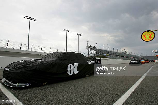 The Jack Daniel's Chevrolet of Clint Bowyer, sits covered on pit road as rain begins to fall prior to the NASCAR Nextel Cup Series Dodge Avenger 500...