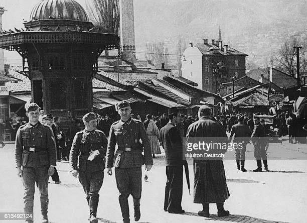 The Jackboot In Sarajevo Again Inquisitive to see the scene of 'Act One' German soldiers are pictured looking around the birthplace of the first war...