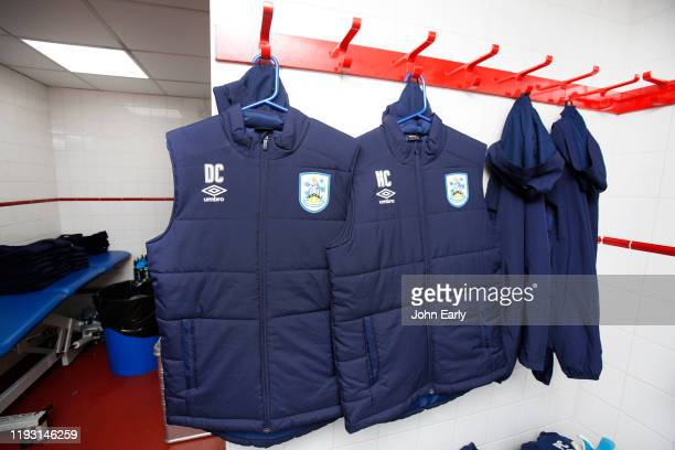 The jacket of Danny Cowley Manager of Huddersfield Town hangs beside his brother Nicky Cowley's jacket in the away dressing room before the Sky Bet...